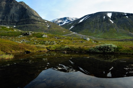 The south peak of the mountain kebnekaise is reflected in the water