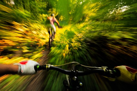 Action photograph of a mountain biker being chased.