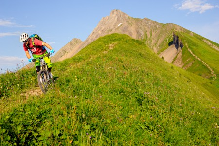 Stefan riding down a steep trail in central Switzerland.