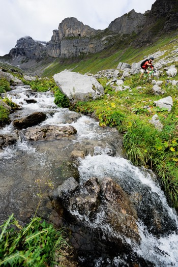 Photograph of a biker riding a trail in Engelberg, Switzerland.