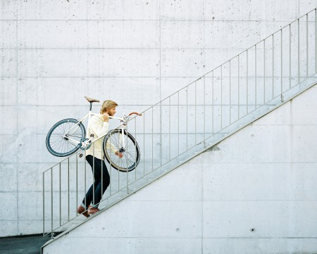 Stefan carries his fixed gear bike up the stairs.