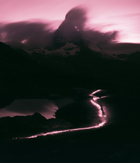 Long exposure photo showing the Matterhorn and a light trail.