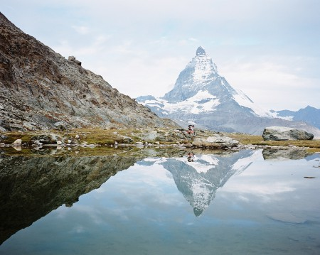Reflection of Stefan Hellberg and the Matterhorn above Zermatt, Switzerland.