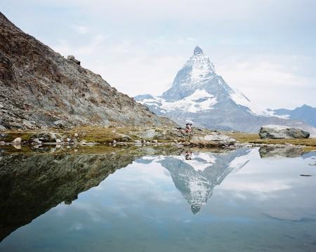 Reflection of Stefan Hellberg and the Matterhorn above Zermatt, Switzerland.